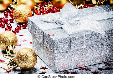 Christmas ornaments and present in silver box
