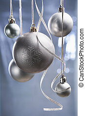 group of silver Christmas ornament with bluish background