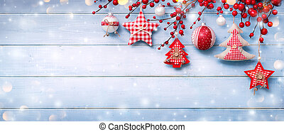 Christmas Ornaments Hanging On Snowy Wooden Plank