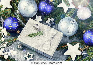 Christmas ornaments in blue tone and present in silver shiny box