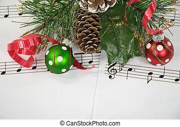 Christmas ornaments on music
