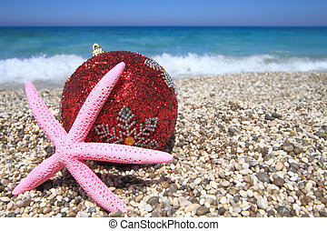 Christmas ornaments on the beach