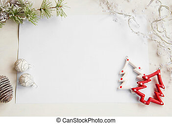 Christmas ornaments on white paper greeting with copy space...