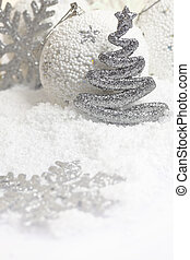 Christmas ornaments on white snowy background