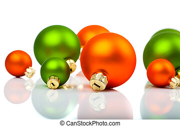 Christmas ornaments - orange and green, on a white background with copy space