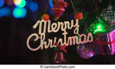 Christmas ornaments with Merry Christmas text on christmas...