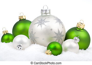 Christmas ornaments with snow - white and green , on a white background with copy space