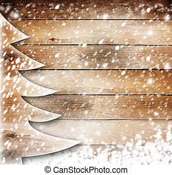 Christmas paper tree on the snow-covered wooden background