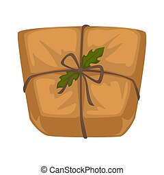Christmas parcel in craft paper with rope and holly leaves