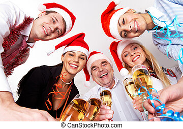 Christmas party - Below angle of happy company with flutes ...