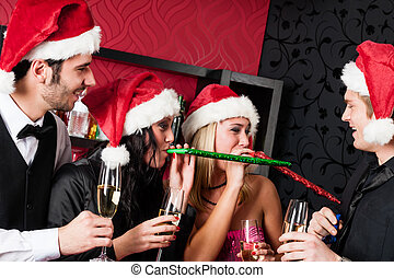 Christmas party friends have fun at bar - Christmas party...