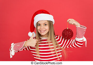 Christmas party. Winter holidays. Playful mood. Christmas celebration ideas. Shine and glitter. Child Santa Claus costume hat. Happy smiling face. Beautiful detail. Positivity concept. Cheerful mood