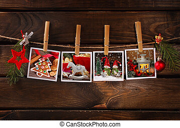 christmas photos hanging on rope against wooden background...