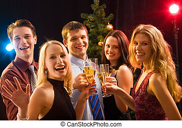 Christmas - Smiling group of young people enjoying cocktails...