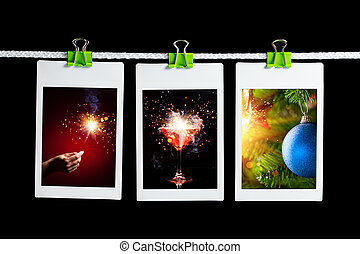 christmas pictures hanging on rope, black background