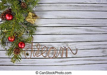 Christmas pine bough on wood