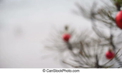 Christmas pine tree and red bauble in winter slide truck...