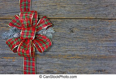 Christmas plaid bow on wood