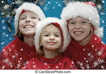Christmas portraits - Children wearing Santa Claus hats and...