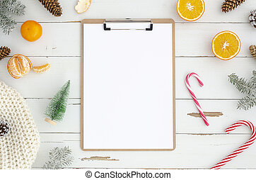 Christmas postcard mockup. Clipboard with a blank paper list and copy space for greeting text or lettering