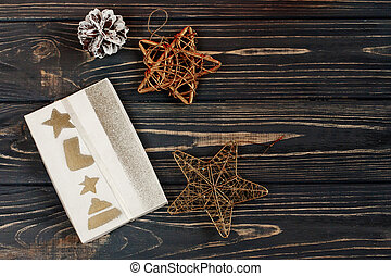 05131133eedba christmas present box and golden stars toys on stylish black rustic wooden  background. space for