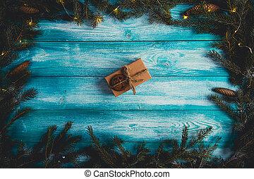 Christmas present on a blue wodden table