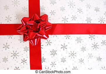 Christmas Present - A beautiful red bow and ribbon on a...