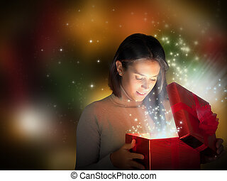 Christmas present - Magic Christmas present with surprised...