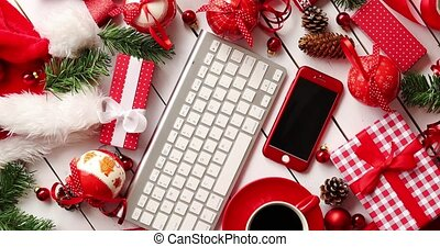 Christmas presents and decorations around gadgets and...