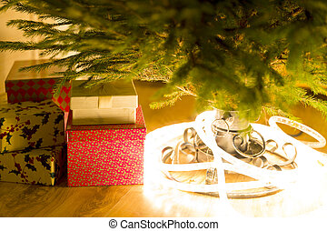 Christmas presents and lights under the evergreen christmas tree