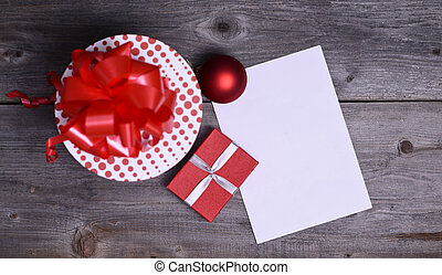 Christmas Presents and Ornaments on Wooden Background with blank paper