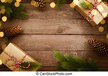 Christmas presents in kraft box on vintage wooden table with decorations