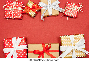 christmas presents laid on red paper