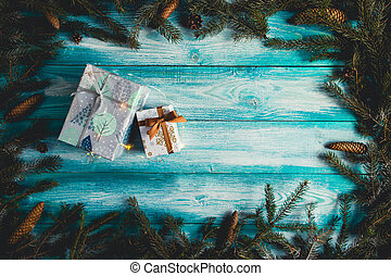 Christmas presents on blue wooden table