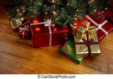Christmas Presents under a Christmas tree - Wrapped gifts ...
