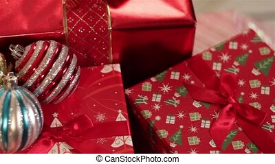 Christmas Presents under a tree - wrapped gifts under a...