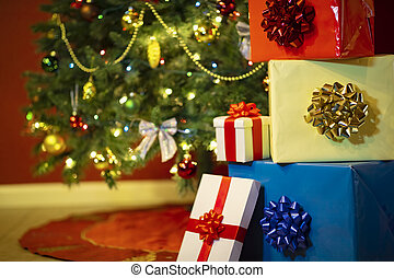 Christmas presents with christmas tree lights on background