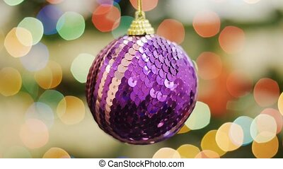Christmas purple ball shakes at background bokeh