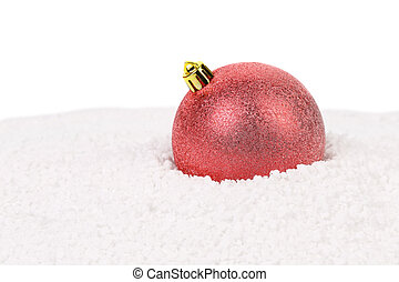Christmas red ball on a snow.