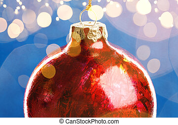 Christmas red ball on background with golden lights