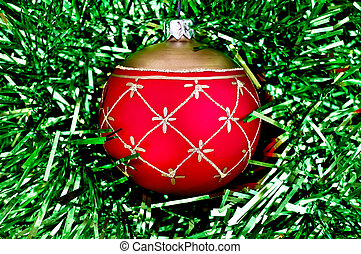 Christmas red ball on the green tinsel