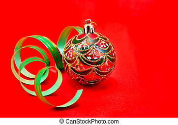 Christmas red ball with green ribbon