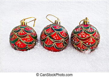 Christmas red balls in the snow