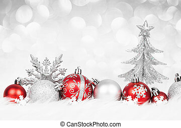 Christmas red balls with silver decoration on the snow. Xmas...