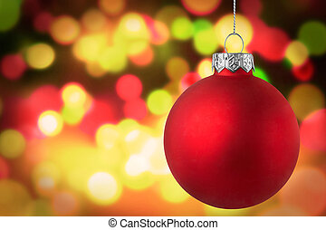 Christmas red bauble over bokeh background