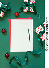Christmas red blank for letter to Santa on green.