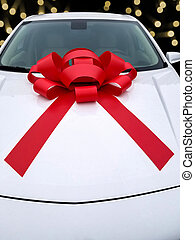 Christmas red bow on car