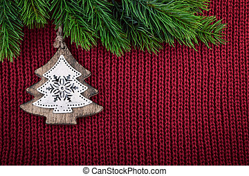 Christmas Red Knitted Background With Tree Decoration In Country Farmhouse Style