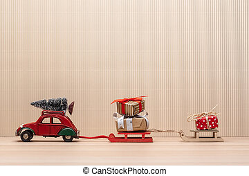 christmas red toy car with sledges gift fir-tree