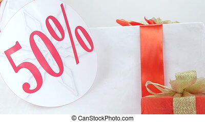Christmas red white gift boxes with fifty percent sale discount sign